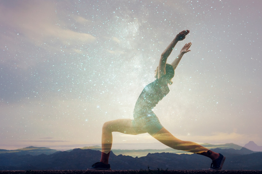Double exposure of woman doing yoga and starry sky